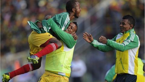 Ethiopia players celebrate scoring against Nigeria in the first leg