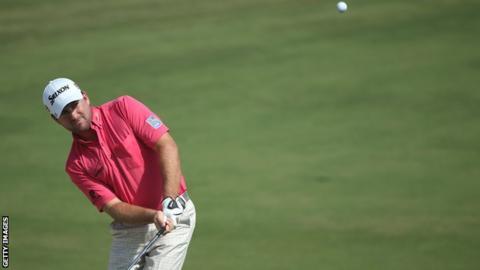 Graeme McDowell plays a chip in Dubai