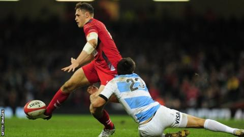 Wales centre Cory Allen rides a tackle against Argentina