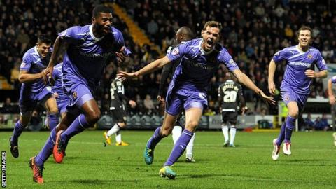 Ethan Ebanks-Landell celebrates his winner for Wolves at Notts County