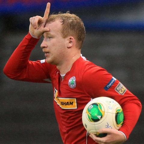 Liam Boyce celebrates after scoring one of his two goals in Cliftonville's exciting 4-2 win over Coleraine