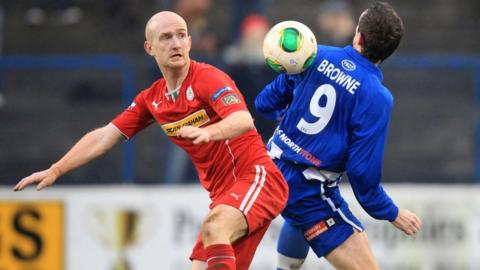 It was end to end action for Cliftonville's Ryan Catney and Gary Browne of Coleraine at the Showgrounds