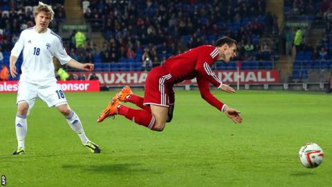 Wales forward Gareth Bale is fouled by Finland's Jere Uronen