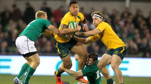 Australia full-back Israel Folau is tackled by Ireland's Luke Marshall and Brian O'Driscoll