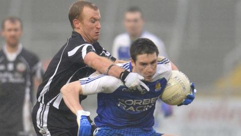 Kilcoo's Gerard McEvoy gets to grips with Ballinderry opponent Gareth McKinless at the Atheltic Grounds in Armagh