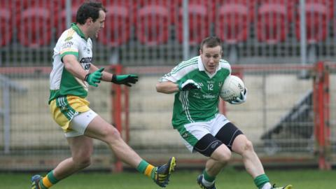 Michael Murphy moves in to challenge Roslea forward Peter Lynch in Glenswilly's 3-9 to 2-8 win over the Fermanagh side