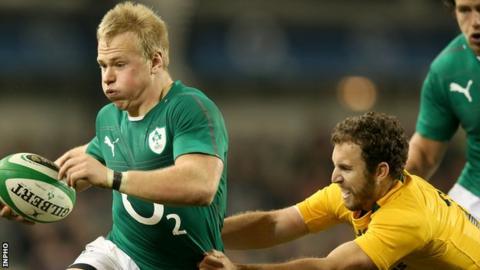 Luke Marshall in action for Ireland against Nic White of Australia