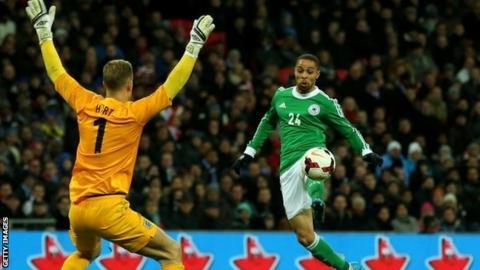 England goalkeeper Joe Hart and Germany's Sidney Sam