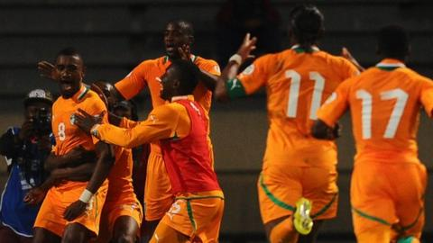 Ivory Coast celebrate scoring against Senegal in their World Cup play-off