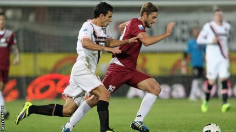 Nicola Rogoni of Reggina competes for the ball with Sinisa Andelkovic of Palermo