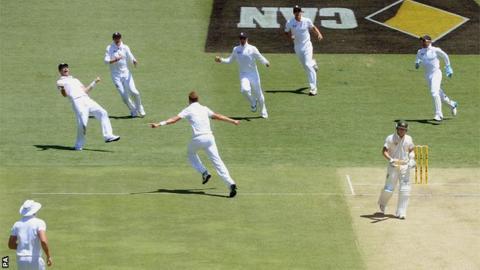 England celebrate after dismissing Michael Clarke