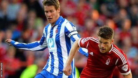 Hartlepool captain Tony Sweeney (left) battles with Nottm Forest's Jamie Mackie