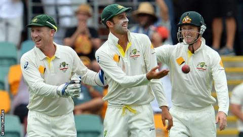 Nathan Lyon (centre) celebrates an England wicket
