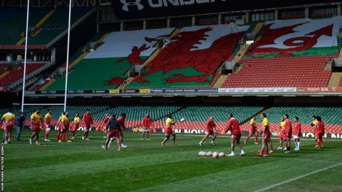 Tonga train in the shadow of the Welsh Dragon flag being assembled at Millennium Stadium ahead of the tourists' Friday clash there against Wales