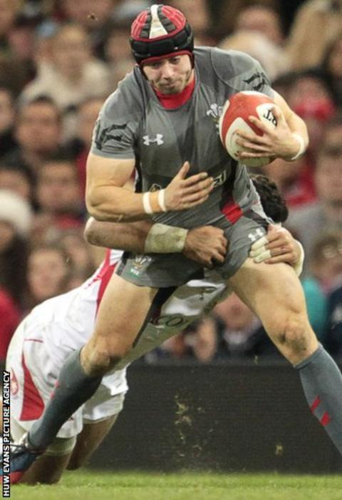 Wales ful-back Leigh Halfpenny, nominated for the IRB's player of the year award, is tackled by Tonga centre Siale Piutau