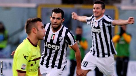 Juventus forward Carlos Tevez scores against Livorno