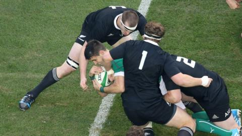 Scrum-half Conor Murray dives over the line for the first of Ireland's three first-half tries