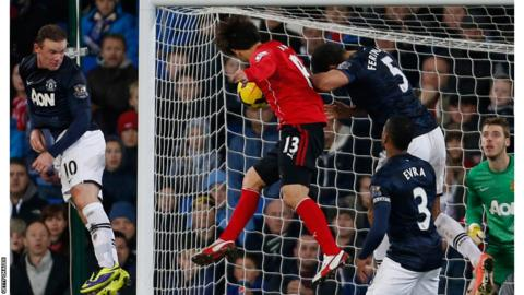 Kim Bo-Kyung heads in Cardiff City's late equaliser against Manchester United and . . .