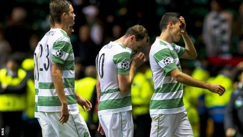 Disappointed Celtic players after the defeat to Milan