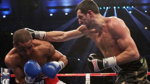 Carl Froch (r) strikes out at Andre Ward in their super middleweight title fight in 2011