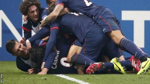 Paris St-Germain's Edinson Cavani celebrates with team-mates after scoring the second goal for the team during their Champions League