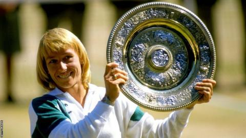 Martina Navratilova holds up the winners' plate at Wimbledon in 1987