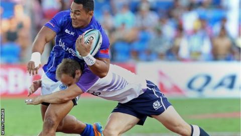 Samoa's Meki Magele is tackled by Scotland's Andrew Turnbull