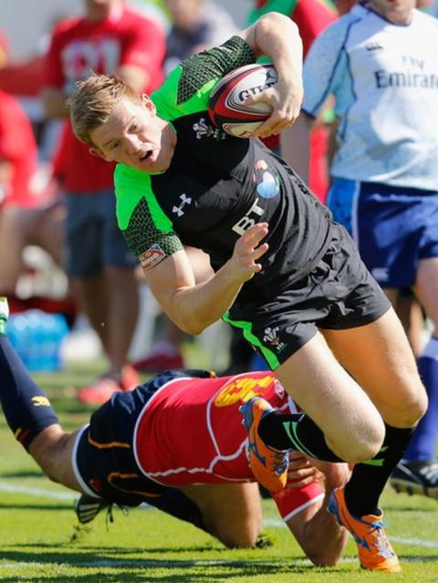 Wales Sevens player Samuel Cross of Wales evades a tackle in their clash with Portugal at the Dubai event