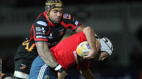 Munster's Duncan Williams is tackled by Newport Gwent Dragons Number Eight Netani Talei in the Pro12 clash at Rodney Parade.