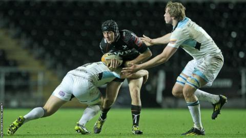 Ospreys fly-half Sam Davies is halted on this occasion