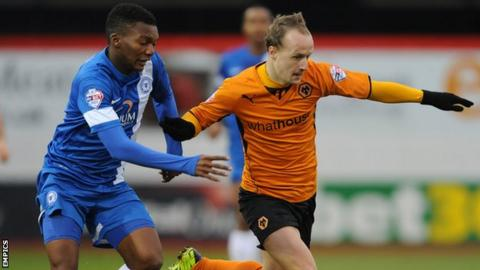 Peterborough United's Kgosi Nthle (left) and Wolverhampton Wanderers' Leigh Griffiths (right) battle for the ball.