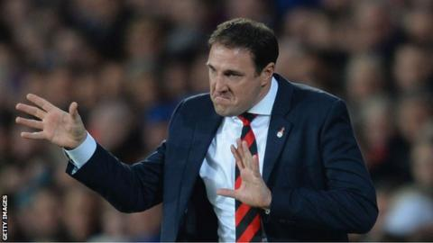 Cardiff manager Malky Mackay gesticulates to his players during the 3-0 defeat against Arsenal