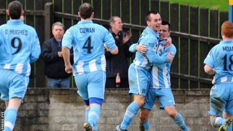 Stephen Hughes celebrates scoring the opener for Warrenpoint against Coleraine