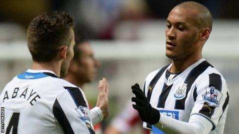 Yoan Gouffran celebrates his goal for Newcastle with team mate Yohan Cabaye