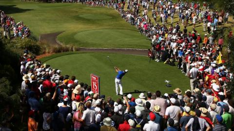 Rory McIlroy hits his drive at the 15th hole on his way to a closing round of 66 and a one-shot victory over world number two Adam Scott