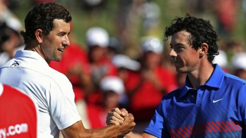 Australian Adam Scott shakes hands with winner Rory McIlroy after their exciting tussle for the Stonehaven Cup