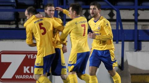 Hat-trick hero Darren Boyce is congratulated by Dungannon Swifts after scoring during the 3-1 win at Glenavon