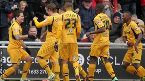 Newport celebrate their opening goal against Chesterfield