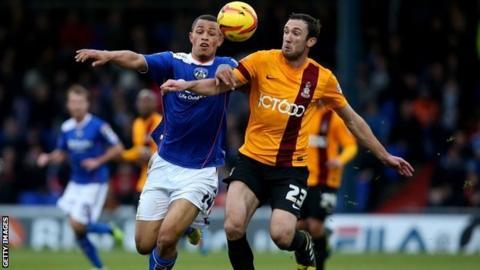 Jonson Clarke-Harris battles for possession