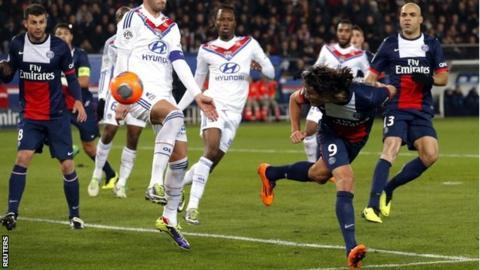 Paris St Germain's Edinson Cavani scores his side's first goal