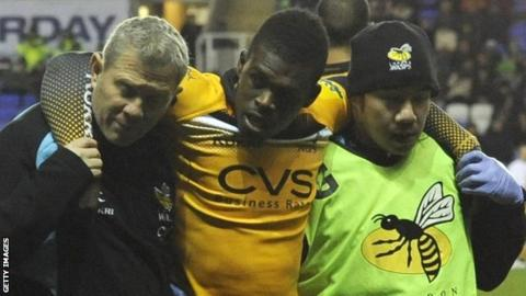Christian Wade is helped off the pitch after injuring his ankle
