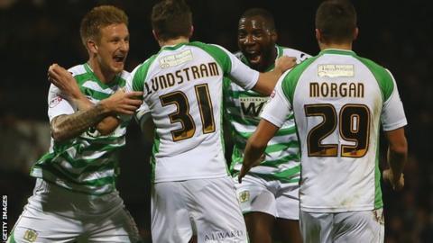 Yeovil players celebrate beating Blackpool