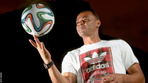 The Brazuca is being held by Brazil captain Cafu