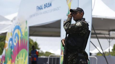 A soldier secures the entrance of the draw hall before the draw for the 2014 soccer World Cup in Costa do Sauipe