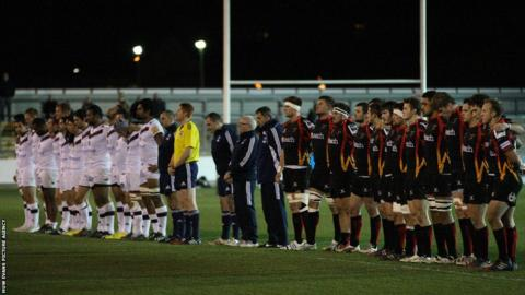 Newport Gwent Dragons and Bordeaux-Begles observe a minute's silence as a mark of respect for Nelson Mandela, ahead of their Amlin Challenge Cup match at Rodney Parade