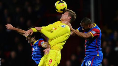 Andreas Cornelius Cardiff City rises above Mile Jedinak and Danny Gabbidon (right), but the visitors lose 2-0