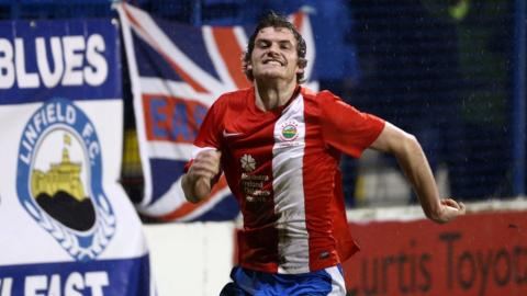 Philip Lowry celebrates after scoring Linfield's late winning goal against Coleraine at Ballycastle Road
