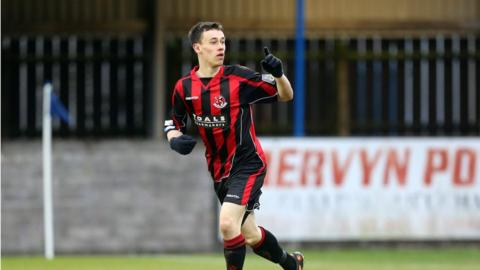 Paul Heatley salutes Crusaders supporters after scoring the winning goal for his side at Dungannon