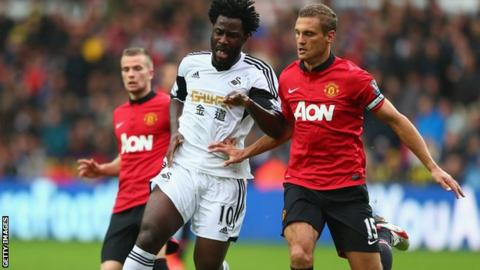 Swansea City's Wilfried Bony and Manchester United's Nemanja Vidic in action in the Premier League