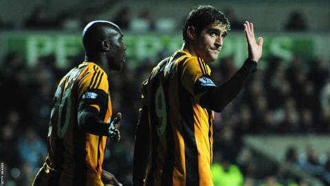 Ex-Swansea City Danny Graham makes an apologetic wave to the home fans after giving Hull City the lead against his former club in Monday evening's Premier League clash.
